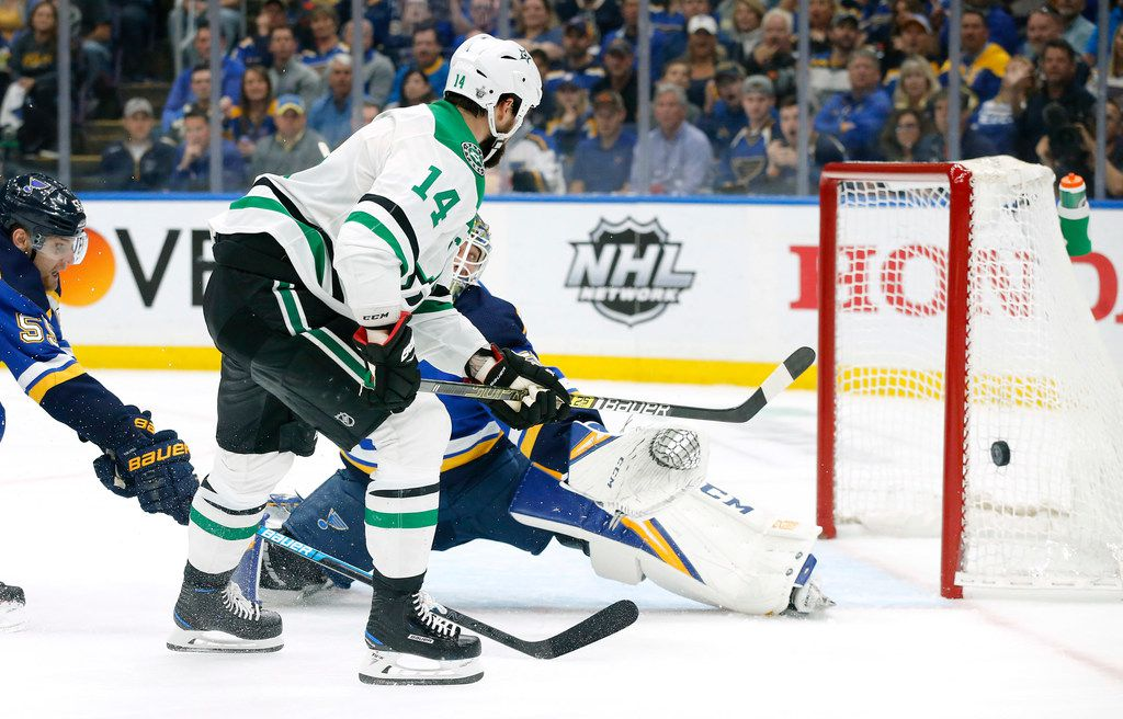 Dallas Stars left wing Jamie Benn's (14) shot is deflected by St. Louis Blues goaltender Jordan Binnington (50) during the second period at the Enterprise Center in St. Louis, Tuesday, May 7, 2019. The teams were playing in the Western Conference Second Round Game 7 of the 2019 NHL Stanley Cup Playoffs. (Tom Fox/The Dallas Morning News)
