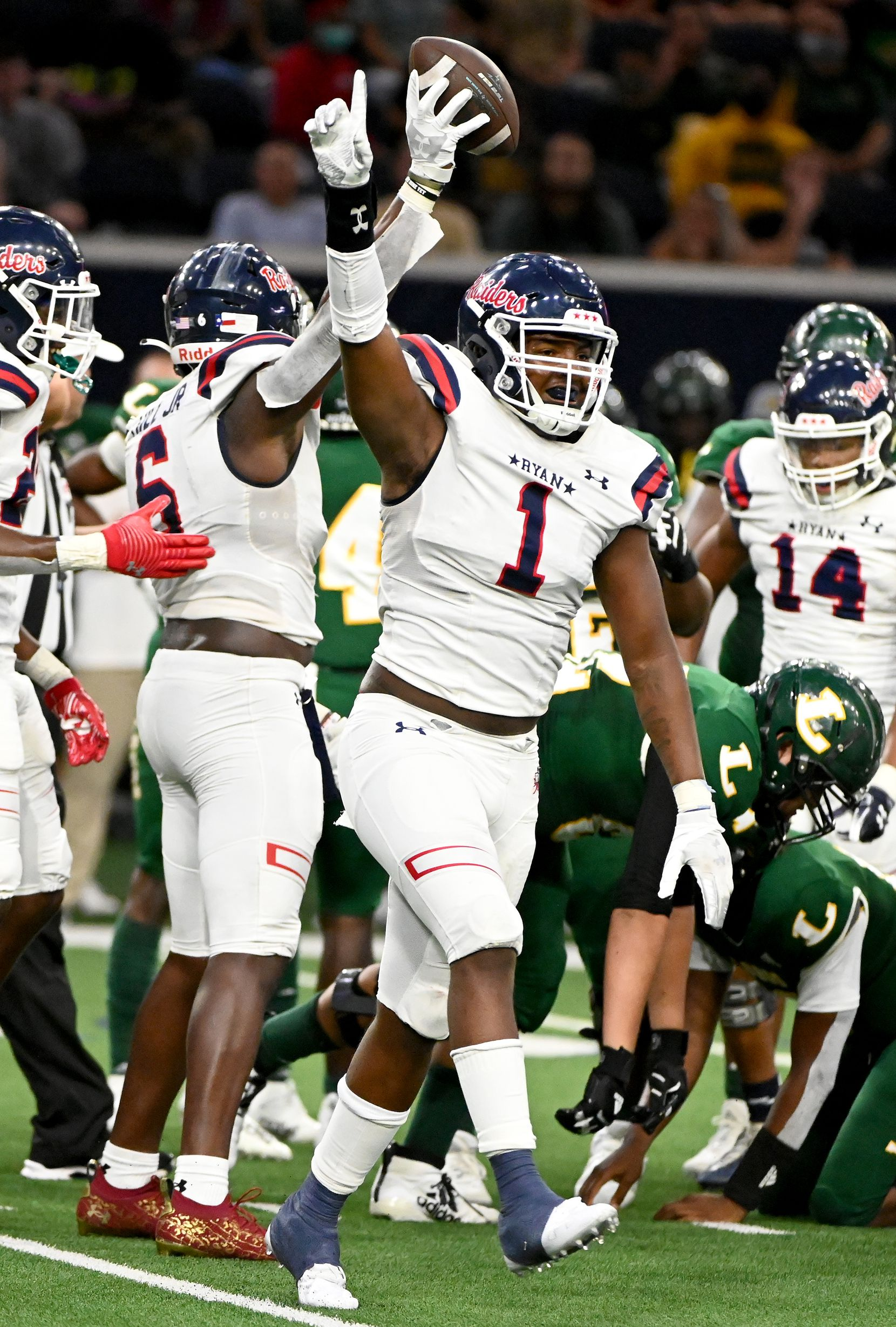 Denton Ryan's MarQuice Hill II (1) celebrate after his teams fumble recovery in the first half during a high school football game between Longview and Denton Ryan, Saturday, Aug. 28, 2021, in Frisco, Texas. (Matt Strasen/Special Contributor)