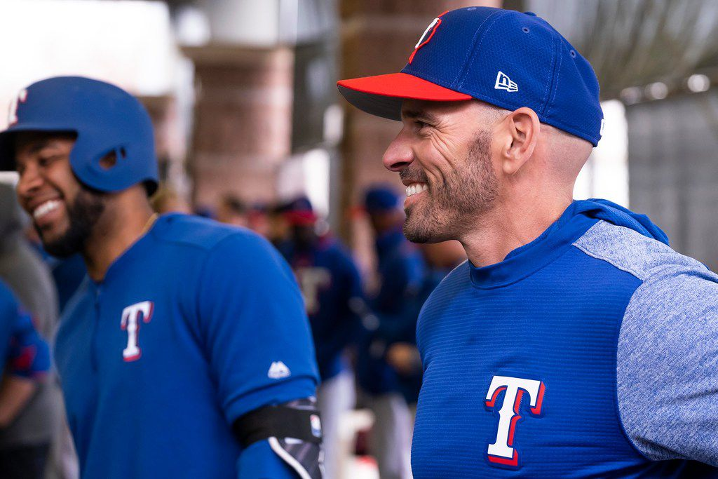 Texas Rangers manager Chris Woodward and shortstop Elvis Andrus watch batting practice during a spring training workout at the team's training facility on Thursday, Feb. 21, 2019, in Surprise, Ariz..