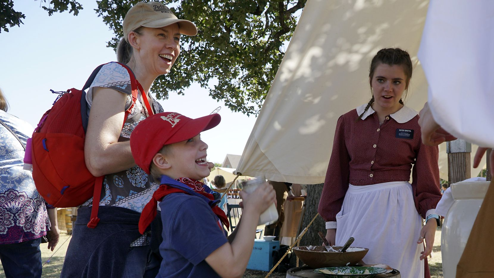 Missy Tucker (left) and her son Samuel Tucker tried making butter as Bailee Bristol looked on during a visit to Nash Farm last fall.