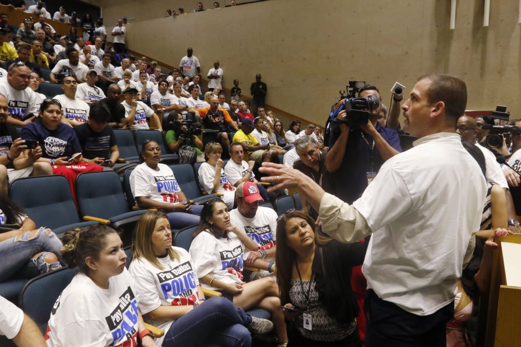 Cristian Hinojosa, president of the Dallas Hispanic Firefighters Association, spoke to Dallas police officers, first responders and their supporters after a City Hall meeting to ask for raises last week.