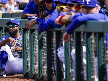 Texas Rangers outfielder Danny Santana takes in the action from the top of the dugout steps during the second inning of a spring training game against the Chicago Cubs at Surprise Stadium on Thursday, Feb. 27, 2020, in Surprise, Ariz.