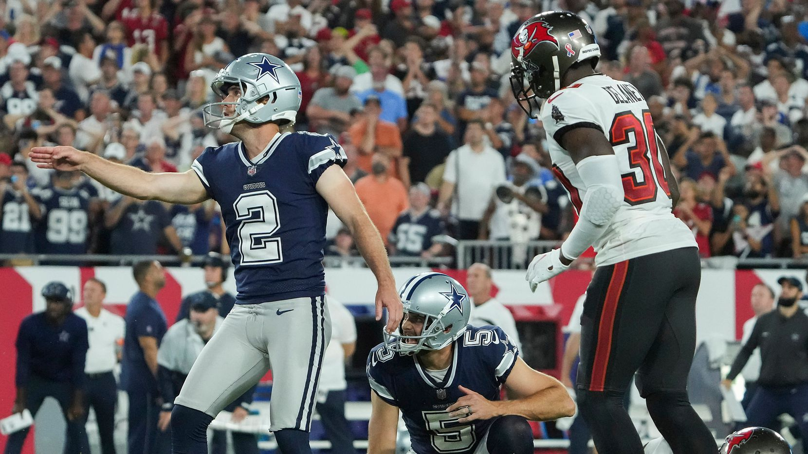 Dallas Cowboys place kicker Greg Zuerlein (2) watches a field goal that gave the Cowboys a brief 29-28 lead in the final minutes of a loss to the Tampa Bay Buccaneers in an NFL football game at Raymond James Stadium on Thursday, Sept. 9, 2021, in Tampa, Fla. The  Buccaneers won the game 31-29. (Smiley N. Pool/The Dallas Morning News)