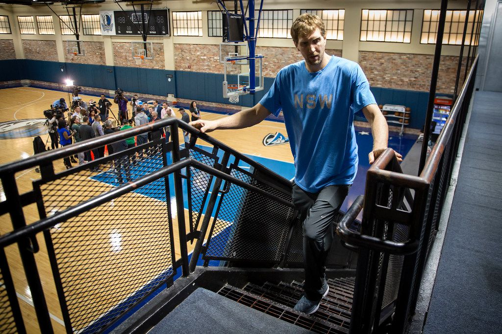 Dallas Mavericks forward Dirk Nowitzki leaves the floor while forward Harrison Barnes takes questions as Mavericks players conduct exit interviews at American Airlines Center following the end of a 33-49 season on Thursday, April 13, 2017, in Dallas. (Smiley N. Pool/The Dallas Morning News)