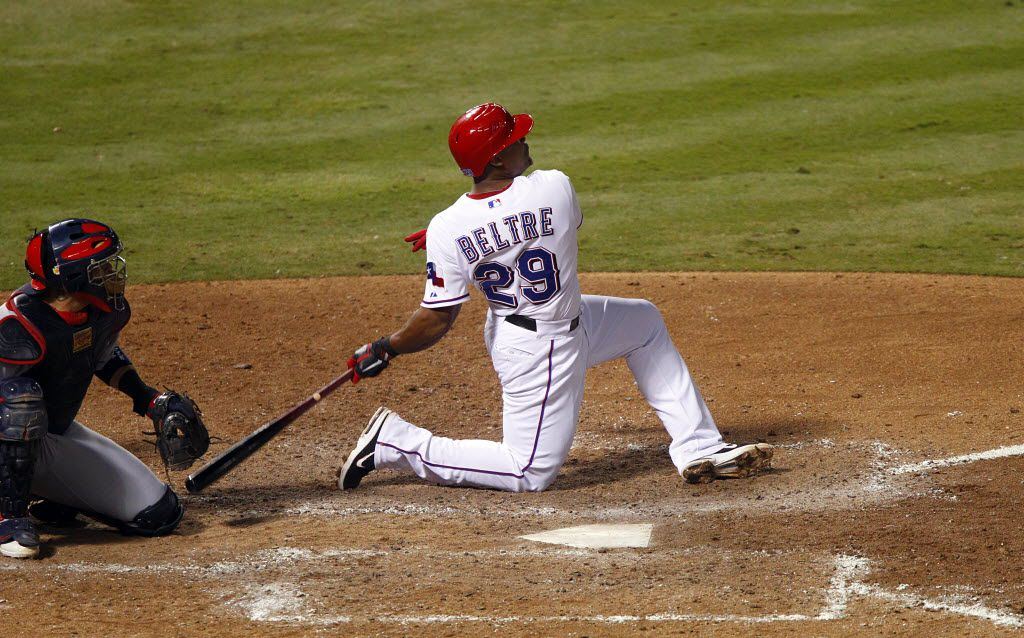 Twisting to his knee on the follow through, Texas Rangers batter Adrian Beltre homered to left  in the sixth inning during Game 5 of the World Series against the St. Louis Cardinals at Rangers Ballpark in Arlington on Monday, Oct. 24, 2011. (Tom Fox/The Dallas Morning News)