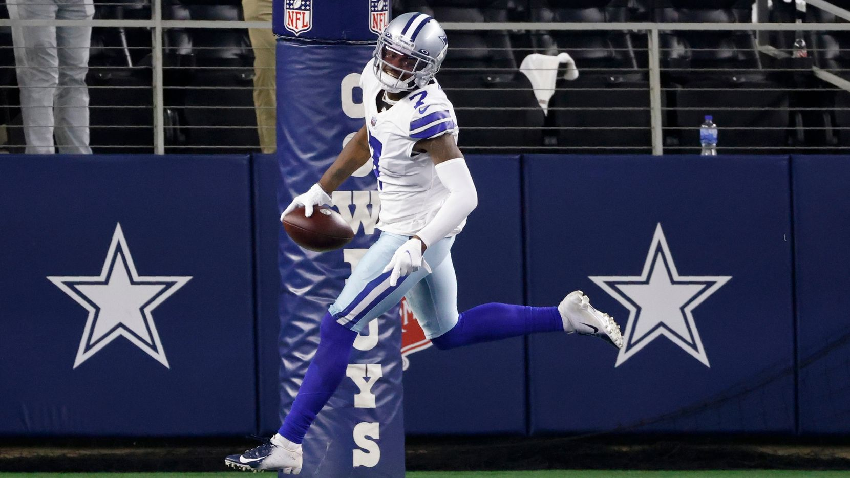 Dallas Cowboys cornerback Trevon Diggs (7) and safety Jayron Kearse (27) celebrate after Diggs intercepted a Philadelphia Eagles' Jalen Hurts pass and returned it for a touchdown in the second half of an NFL football game in Arlington, Texas, Monday, Sept. 27, 2021.