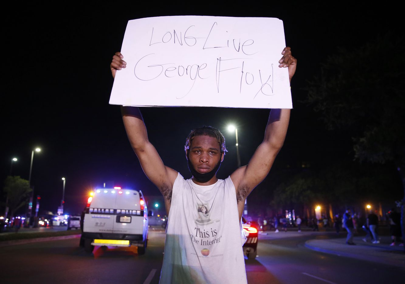 Jordan Spotser of Dallas holds up a sign in front of Dallas police during a demonstration against police brutality in downtown Dallas, on Friday, May 29, 2020. George Floyd died in police custody in Minneapolis on May 25.