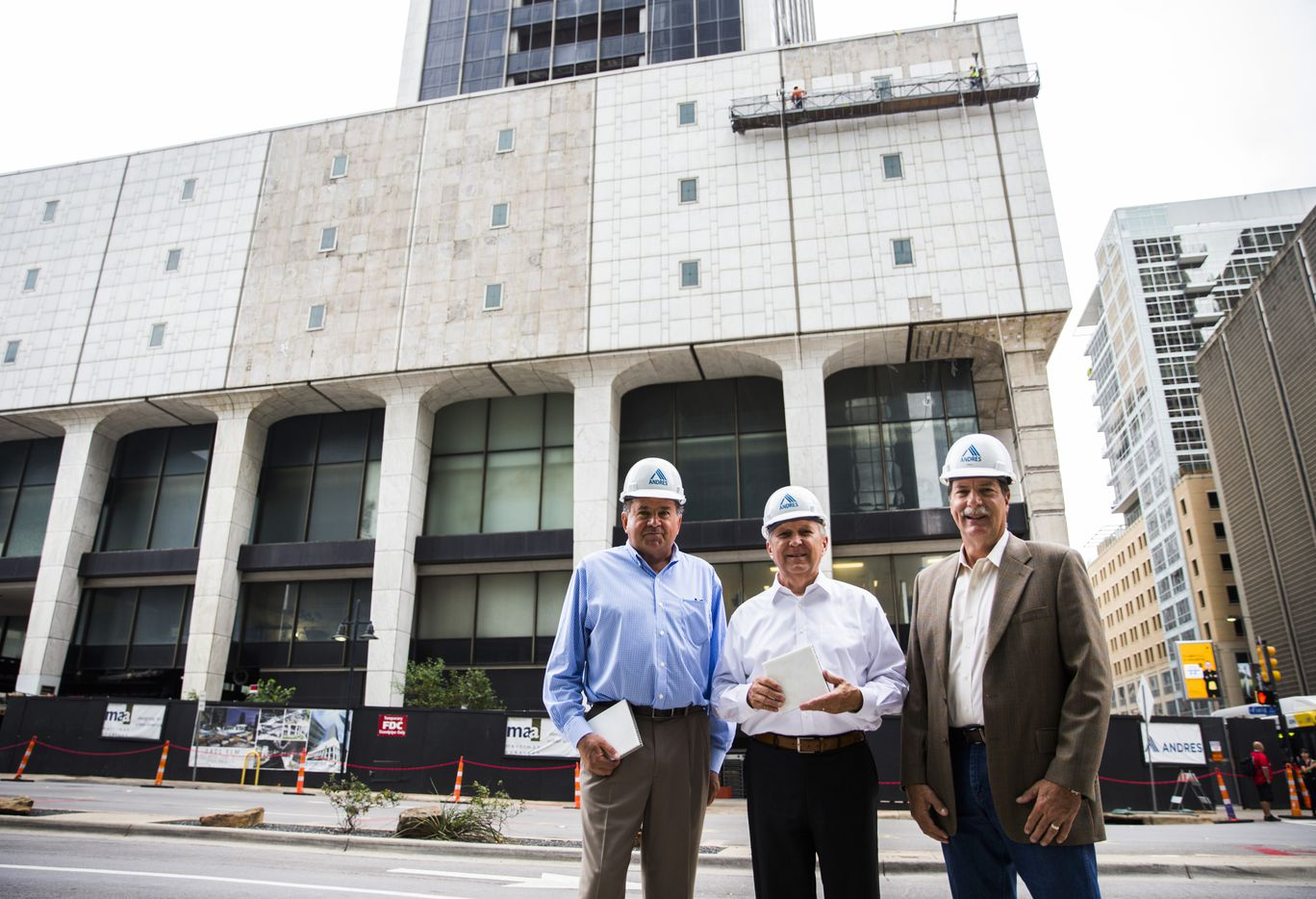Daniel Slain of HyCOMB USA, left, Jerry Merriman, president of Merriman Anderson architects, and Steve McCoy, president of construction at Drever Capital Management at the redevelopment site of the former First National Bank tower in downtown Dallas.