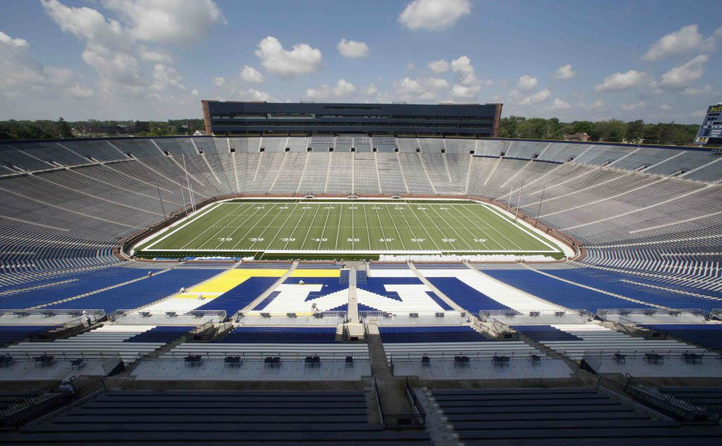 ORG XMIT: MIPS103 Michigan Stadium stands in Ann Arbor, Mich., Wednesday, July 14, 2010. The University of Michigan has figured out just how many fans it can seat in the new-look Big House. The school announced Wednesday the capacity of Michigan Stadium will be 109,901 this season, making it the country's largest football stadium. (AP Photo/Paul Sancya)  07182010xSPORTS
