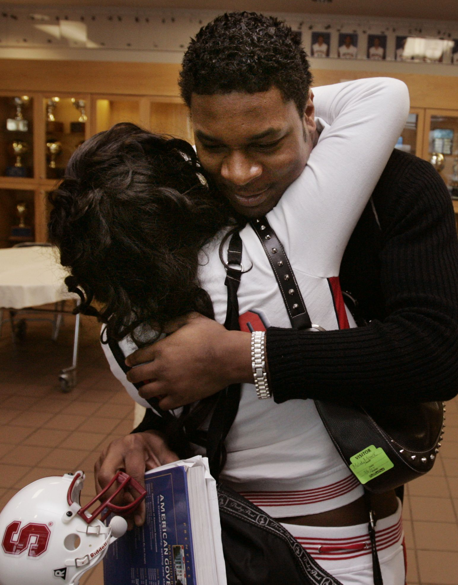 Frisco running back Xxavier Carter gets a hug from his sister Ebony Carter after signing his letter of intent to play football for Stanford on NCAA National Signing Day, Feb. 1, 2005, at Frisco High School. Xxavier signed his letter of intent to play football for Stanford.