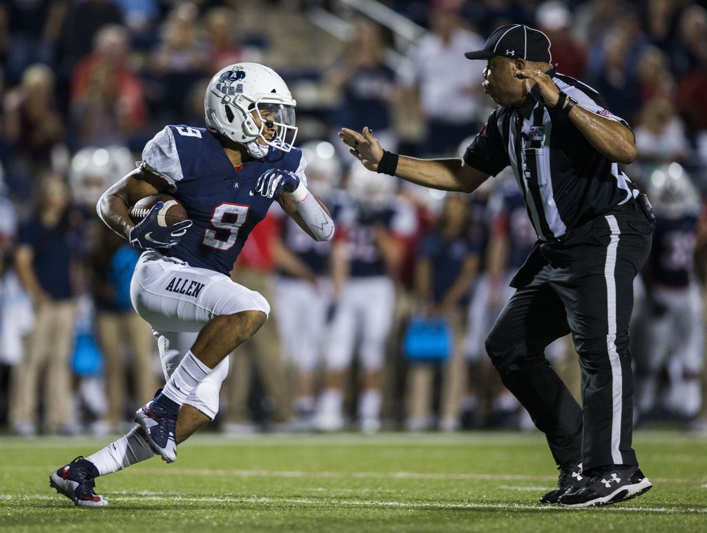 Allen wide receiver Bryson Green (9) nearly runs in to a referee during the second quarter of a high school football game between Allen and Cedar Hill on Friday, August 30, 2019 at Eagle Stadium in Allen. (Ashley Landis/The Dallas Morning News)