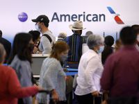 Passengers wait in line to rebook their canceled American Airlines flight in Terminal D at DFW Airport Friday, October 1, 2021. (Tom Fox/The Dallas Morning News)