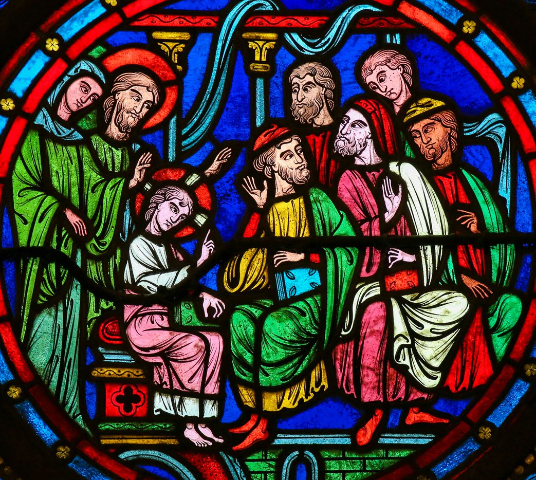 A stained-glass window in the Cathedral of Bayeux, France, depicts Christ among the scholars in the Temple in Jerusalem.