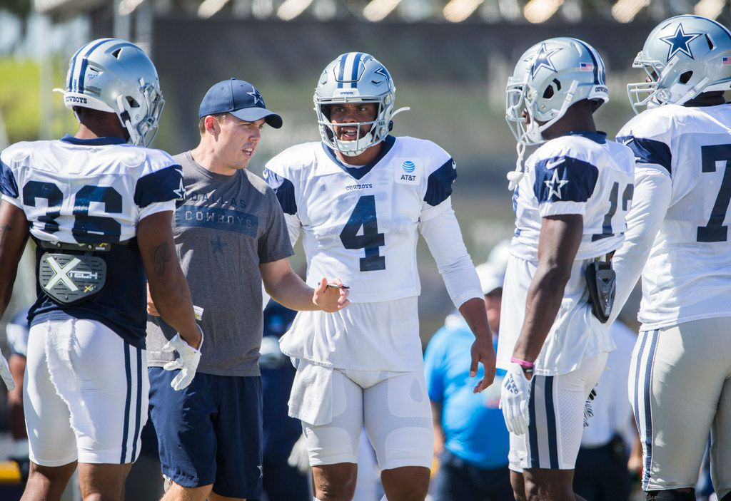 Dallas Cowboys offensive coordinator Kellen Moore calls a play with quarterback Dak Prescott (4) during an afternoon practice at training camp in Oxnard, California on Tuesday, August 13, 2019. (Ashley Landis/The Dallas Morning News)