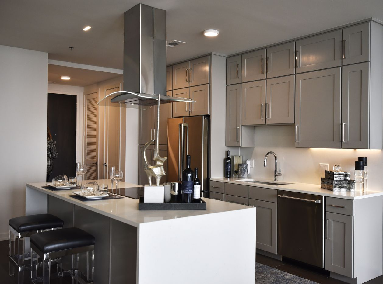 The kitchen area inside a model of a one bedroom at the Twelve Cowboys Way luxury residential tower at the Star in Frisco.