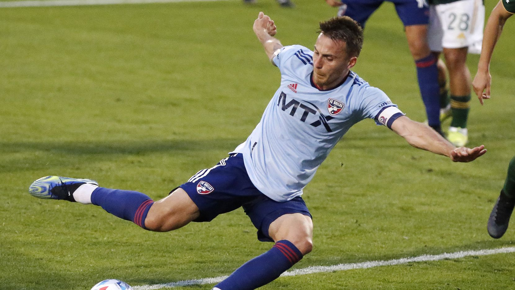 FC Dallas defender Bressan (4) scores the third goal of the game on this kick during the first half as FC Dallas hosted the Portland Timbers at Toyota Stadium in Frisco on Saturday, May 1, 2021.