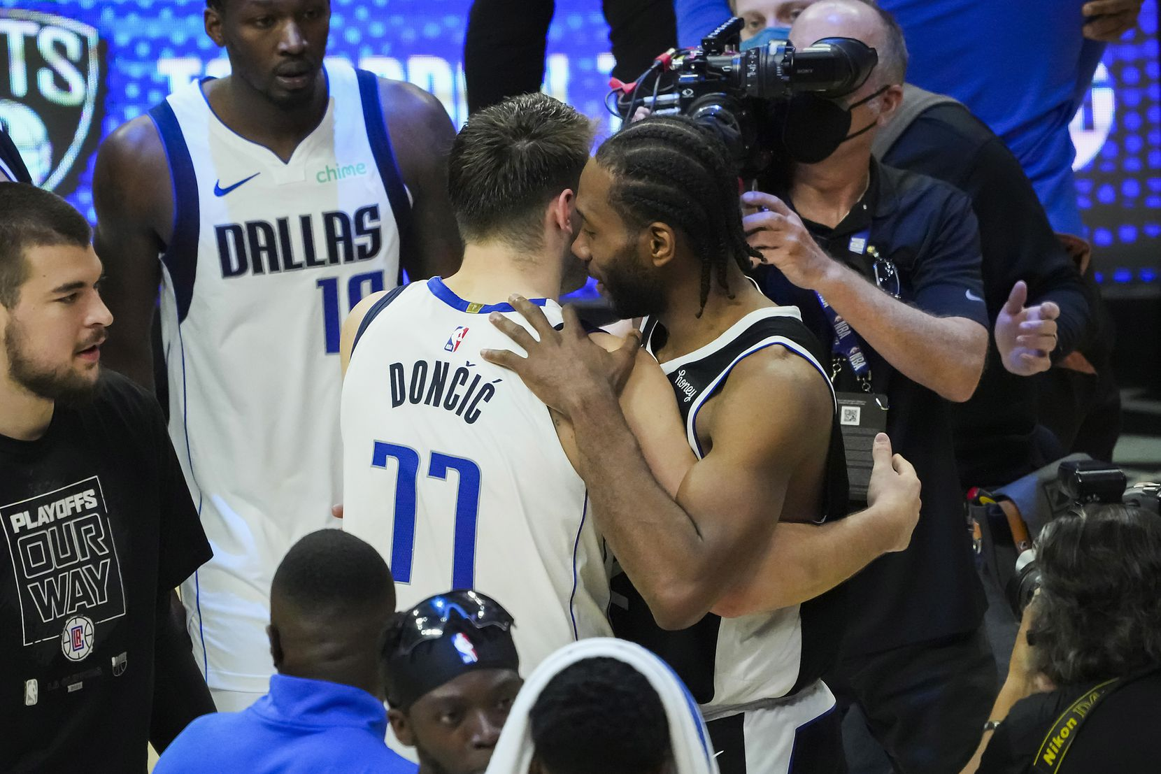 Dallas Mavericks guard Luka Doncic (77) hugs LA Clippers forward Kawhi Leonard after the Clippers victory in Game 7 of an NBA playoff series at the Staples Center on Sunday, June 6, 2021, in Los Angeles.