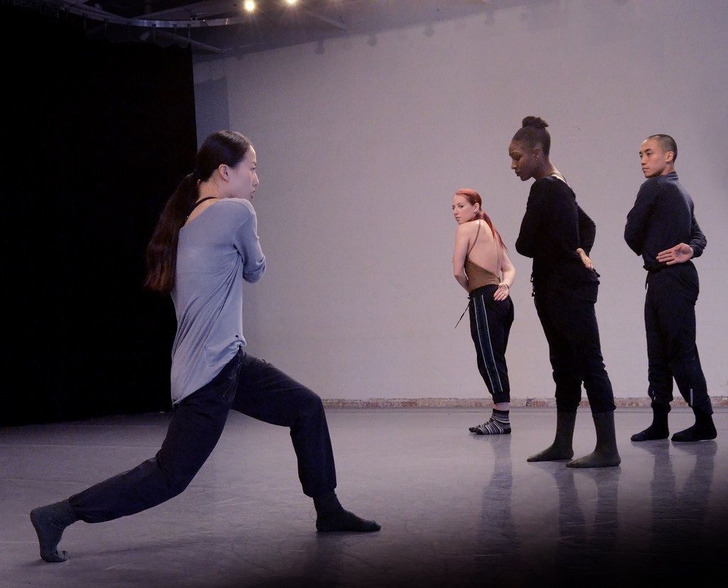 Yin Yue rehearses Bruce Wood Dance company members Emily Drake, Akilah Brooks and Kevin Pajarillaga for the June 14-15 premiere of her new work, Begin Again.