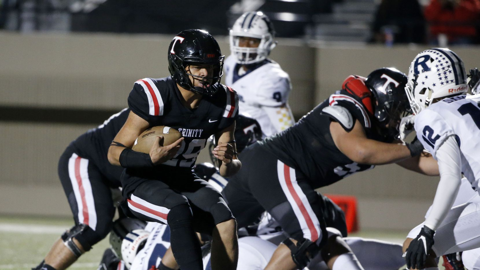 Euless Trinity's Jason Vaomotou (29) scores a rushing touchdown against Richland during the first half of their high school football game on Friday Nov. 8, 2019. (Michael Ainsworth/Special Contributor)
