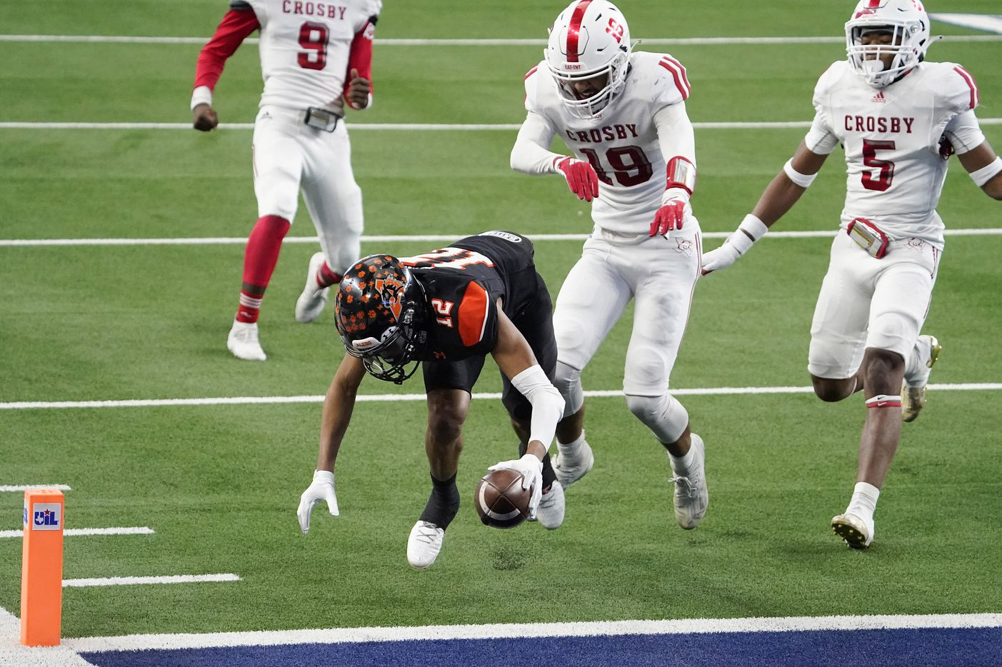 Aledo wide receiver Brian Fleming (12) scores on a 20-yard touchdown reception during the second half of a 56-21 victory over Crosby to win the Class 5A Division II state football championship game at AT&T Stadium on Friday, Jan. 15, 2021, in Arlington. The victory gave the Bearcats the 10th state championship in school history. (Smiley N. Pool/The Dallas Morning News)