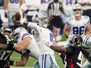 Dallas Cowboys quarterback Dak Prescott throws a pass under pressure from the Atlanta Falcons defense during the first quarter of an NFL football game at AT&T Stadium on Sunday, Sept. 20, 2020, in Arlington.