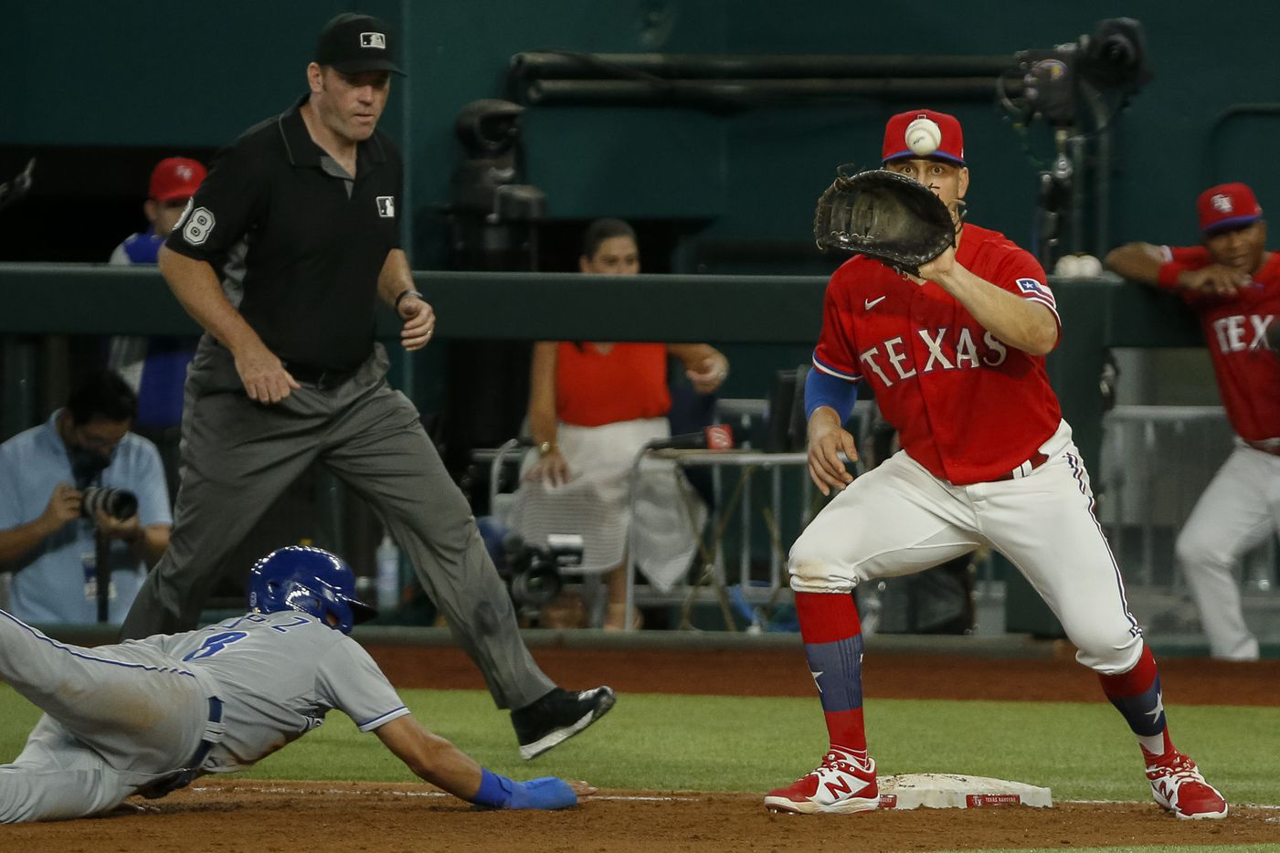 Texas Rangers first baseman Nate Lowe (30) eyes the ball ahead of Kansas City Royals shortstop Nicky Lopez (8) during the third inning at Globe Life Field on Friday, June 25, 2021, in Arlington. (Elias Valverde II/The Dallas Morning News)