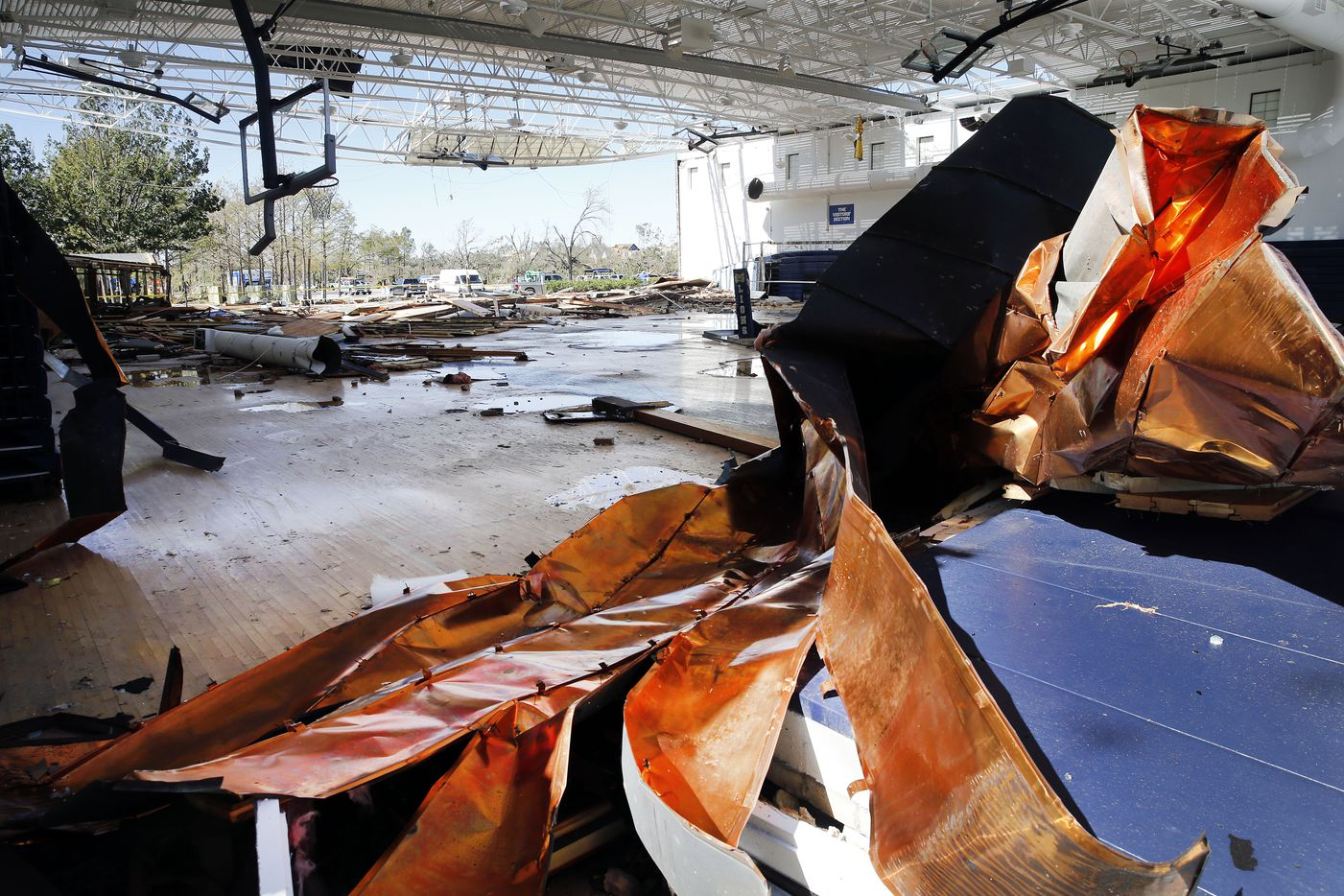 Copper sheeting is crumpled inside the blown open gymnasium at St. Mark's School of Texas following the tornado in Dallas, Monday, October 21, 2019. A tornado tore through the entire neighborhood knocking down trees and ripping roofs from homes. (Tom Fox/The Dallas Morning News)