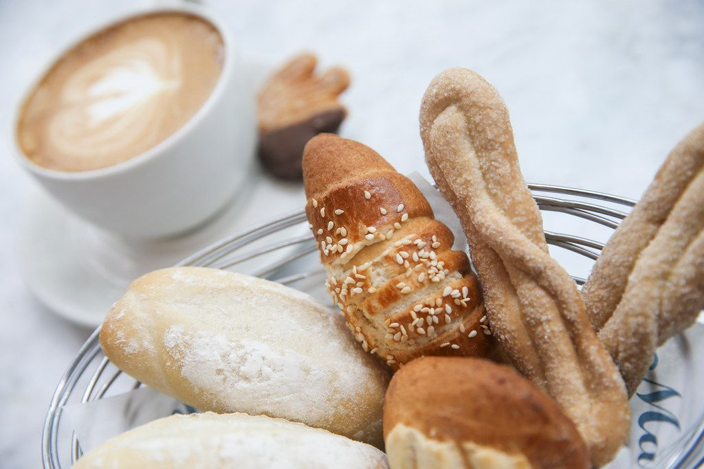 The pastry basket and cafe latte
