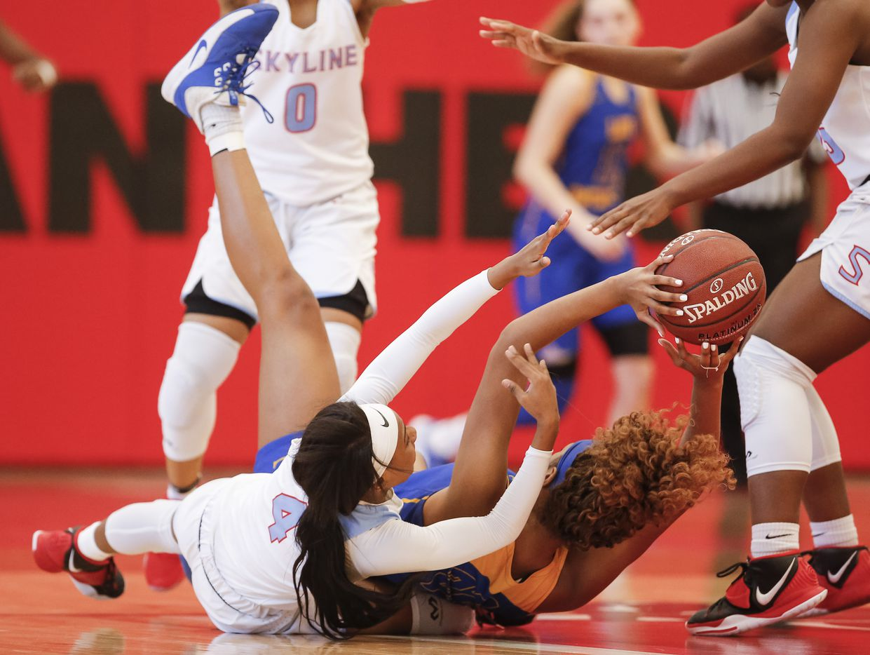 Skyline sophomore Kennedi Johnson (4) battles Lakeview Centennial senior Sanaa Baker, right, for the ball during a girls basketball first-round playoff game at Hillcrest High School in Dallas, Saturday, February 13, 2021. Skyline won 49-42. (Brandon Wade/Special Contributor)