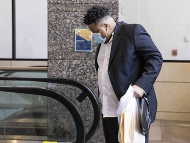 Jonathan Pitts walks off the escalator after visiting the pre-trial services office on Monday, Aug. 16, 2021, at the Frank Crowley Courts Building in Dallas. Pitts, a murder suspect scheduled to go on trial this week, was released from Dallas County jail after it was revealed that the city may have lost evidence in his case. (Juan Figueroa/The Dallas Morning News)
