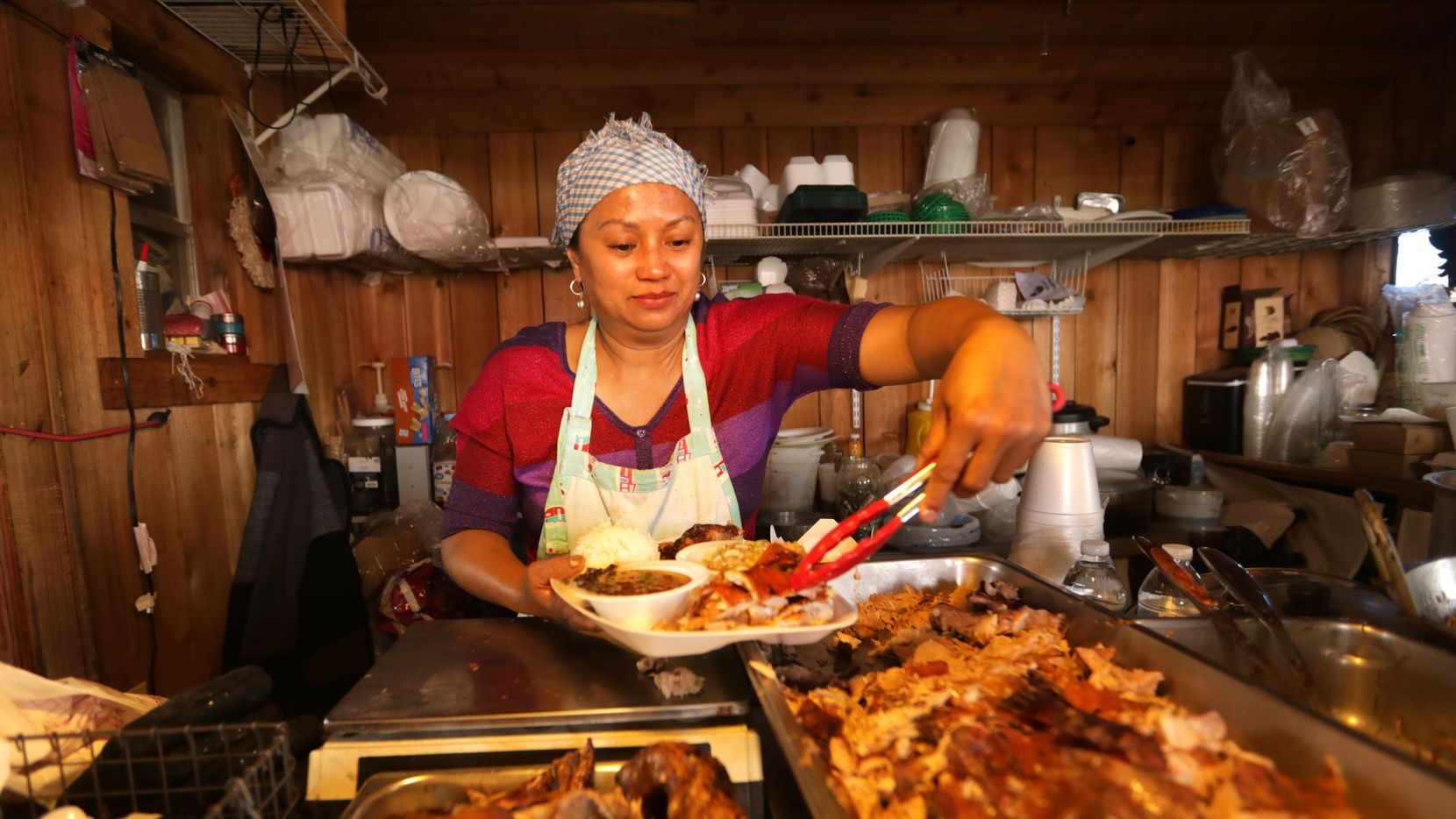 Josephine Cook prepares a plate of food at Old Rooster Creek Filipino Asian/American BBQ in Princeton, TX, on Apr. 24, 2021. (Jason Janik/Special Contributor)