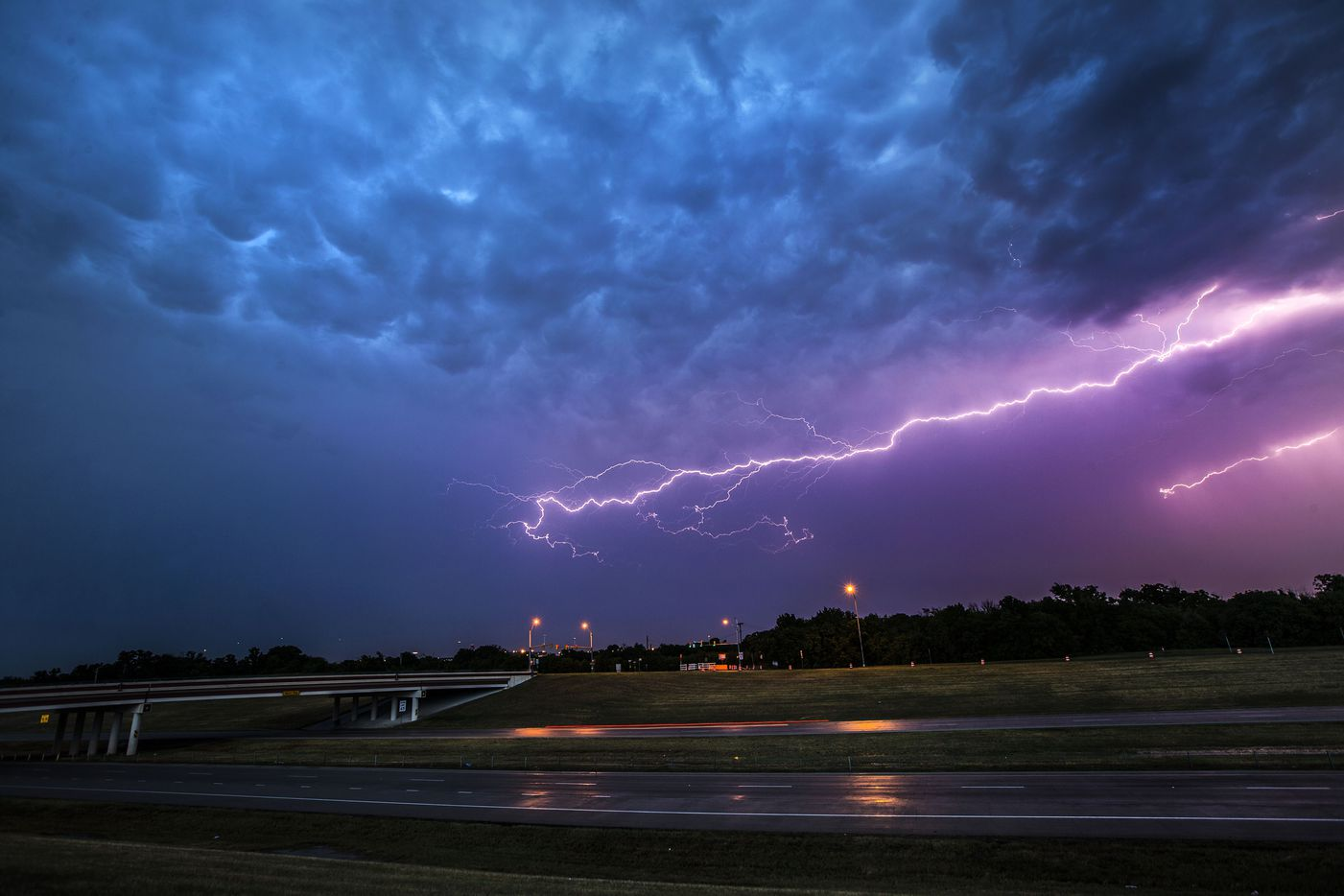 Lightning bolts fill the sky over highway 360 near Euless, Texas on Friday, June 2, 2017. (Ryan Michalesko/The Dallas Morning News)