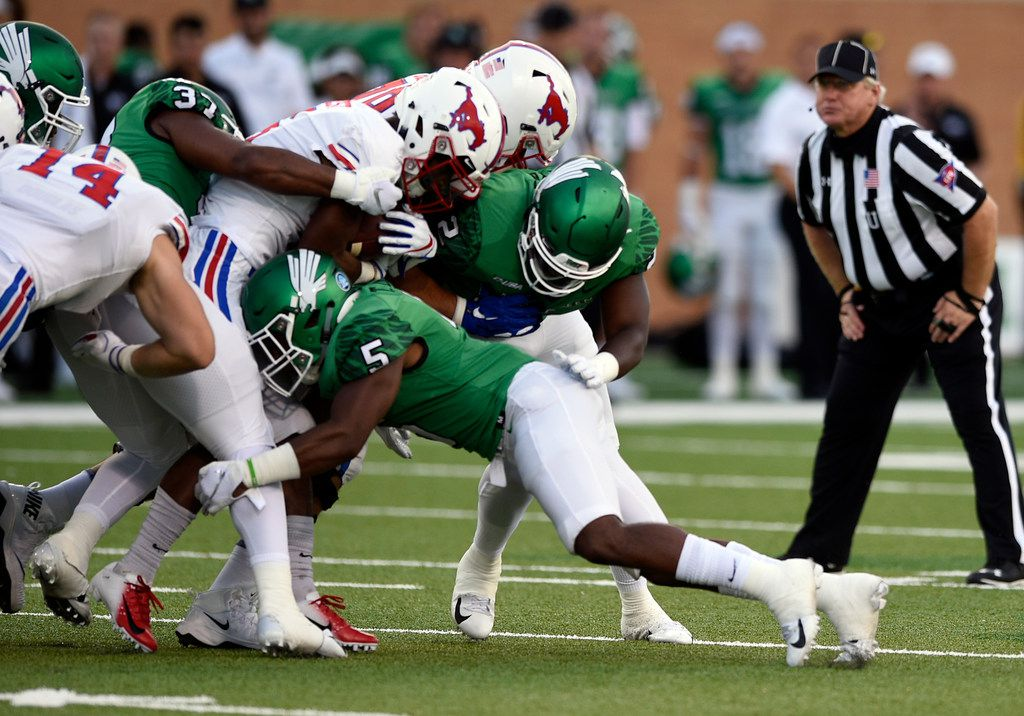 North Texas safety Tyreke Davis (5) makes a tackle during the Mean Green's win over SMU earlier this season at Apogee Stadium. Davis has played a key role for UNT's defense while also boosting the Mean Green's recruiting efforts in the talent-rich Denton area by showing local players can thrive at the school. (Jake King/Denton Record-Chronicle) North Texas Mean Green safety Tyreke Davis (5) charges into Southern Methodist defense during the game against SMU on Saturday, Sept. 1, 2018 at Apogee Stadium in Denton, Texas.  ORG XMIT: txder ORG XMIT: DRC1810081454271393