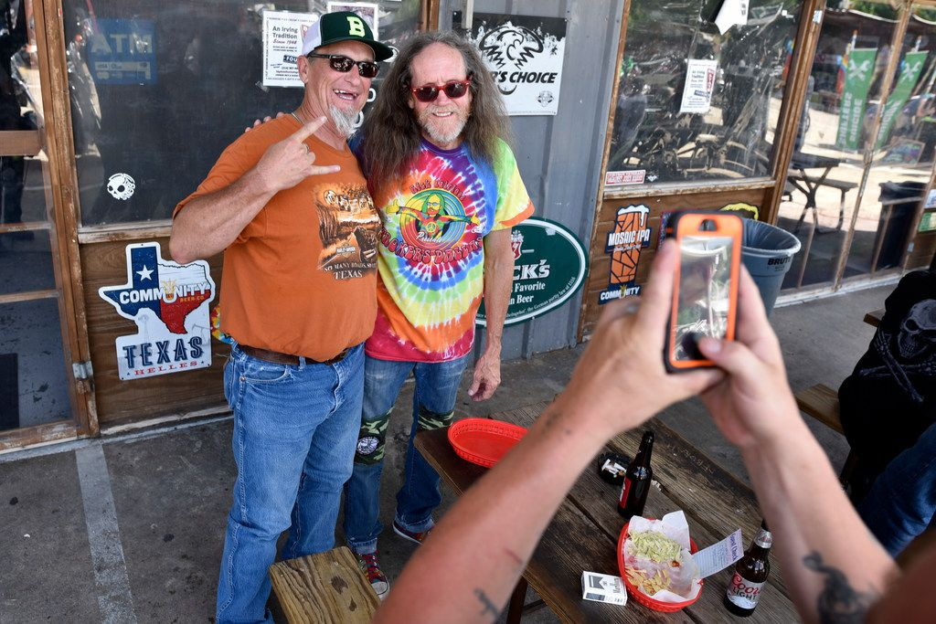 Rex May, 55, of Blum, Texas, is photographed with owner Rick Fairless (right) of Strokers Dallas, on Saturday afternoon, June 16, 2018.