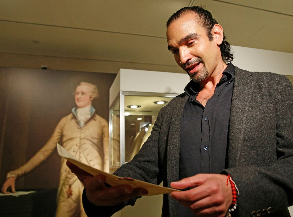 "Javier Munoz, who plays Alexander Hamilton in the hit Broadway musical, tears up as he reads a letter from Hamilton's son Patrick to his father that starts with the words ""Dear Papa,"" Tuesday, Jan. 10, 2017, in New York. (AP Photo/Kathy Willens)"
