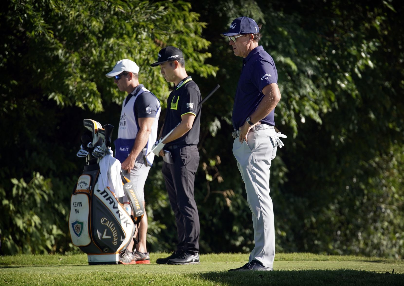 PGA golfers Phil Mickelson (right) and Kevin Na (second from right) observe a minute of silence at 8:46 a.m. for George Floyd during the opening round of the Charles Schwab Challenge at the Colonial Country Club in Fort Worth, Thursday, June 11, 2020. Floyd died in custody as a Minneapolis police officer knelt on his neck.