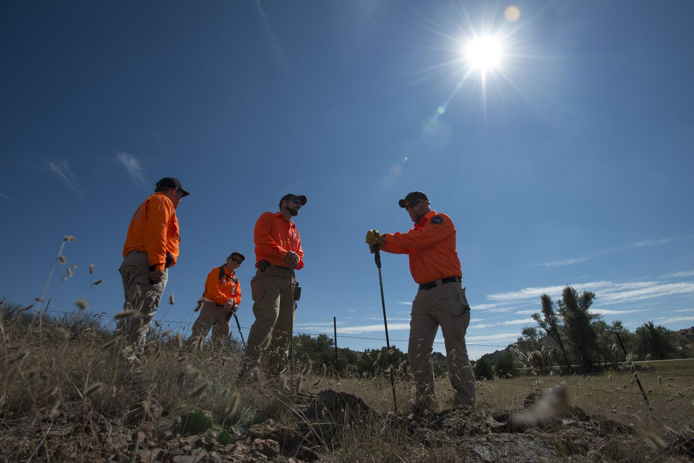 Members of Texas Search and Rescue pause to discuss their plan for searching a hillside between Marfa and Alpine, Texas while searching Saturday, Oct. 22, 2016 for Zuzu Verk.