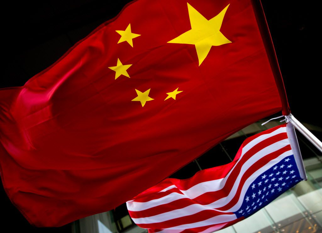 File photo of U.S. and Chinese national flags are hung outside a hotel during the U.S. Presidential election event, organized by the U.S. embassy in Beijing. (AP Photo/Andy Wong)