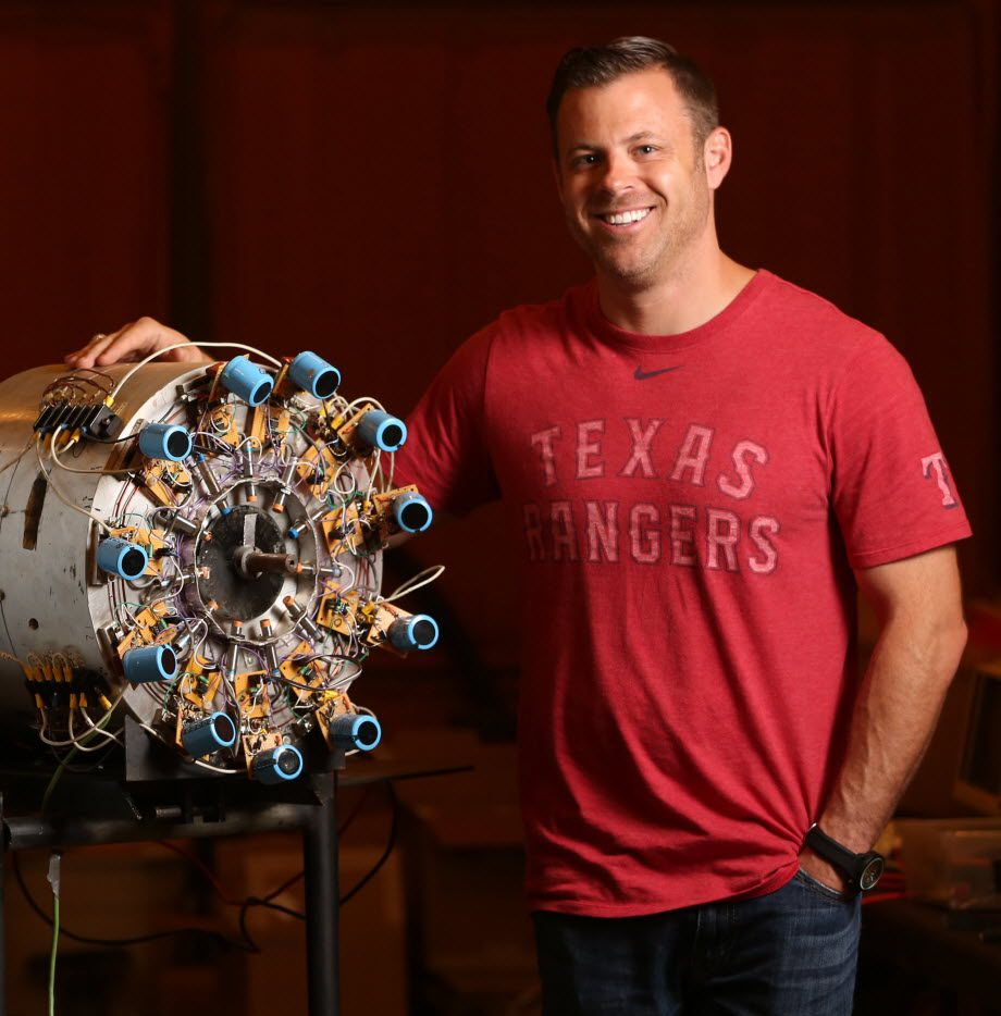 Brad Hunstable stands next to an early prototype of a next generation electric motor he developed with his father Fred Hunstable at their shed for new company, Linear Labs, in Granbury. Brad is the co-founder of Ustream, a live video streaming company that sold to IBM in January.