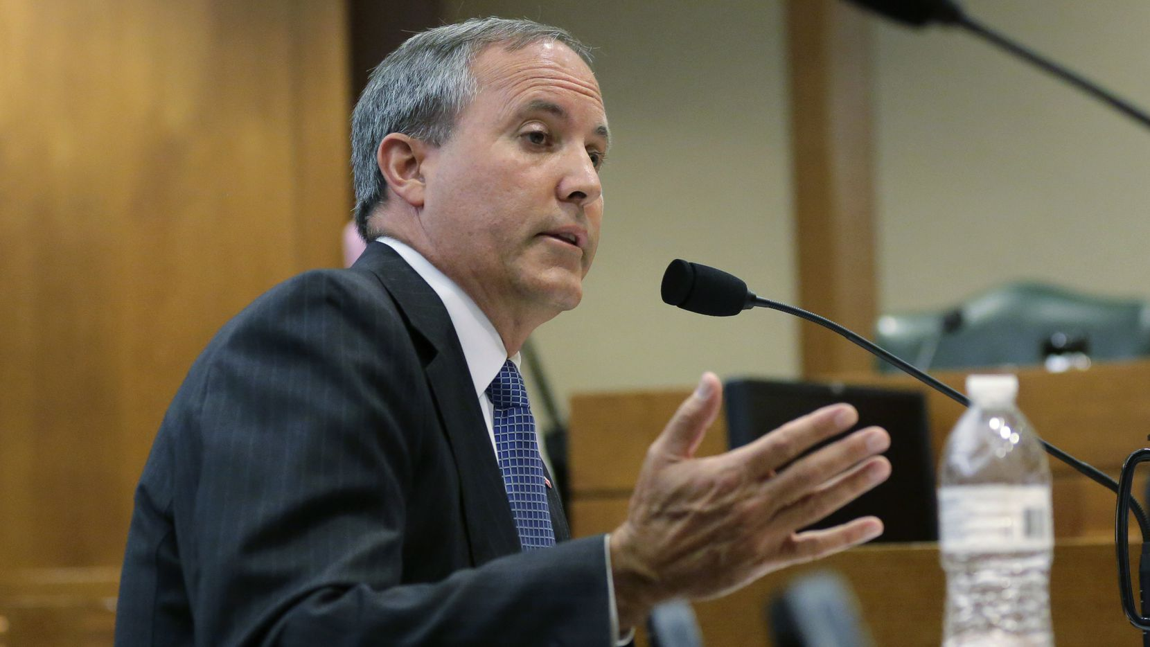 Texas Attorney General Ken Paxton speaks during a hearing in Austin in July.