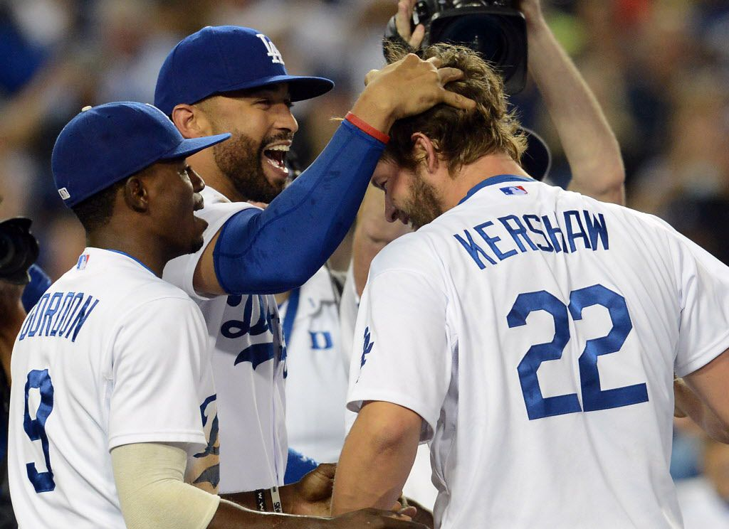 Los Angeles Dodgers starting pitcher Clayton Kershaw (22) celebrates  with left fielder Matt Kemp (27) and second baseman Dee Gordon (9) after the final out of his no-hitter against the Colorado Rockies at Dodger Stadium. Dodgers won 8-0.