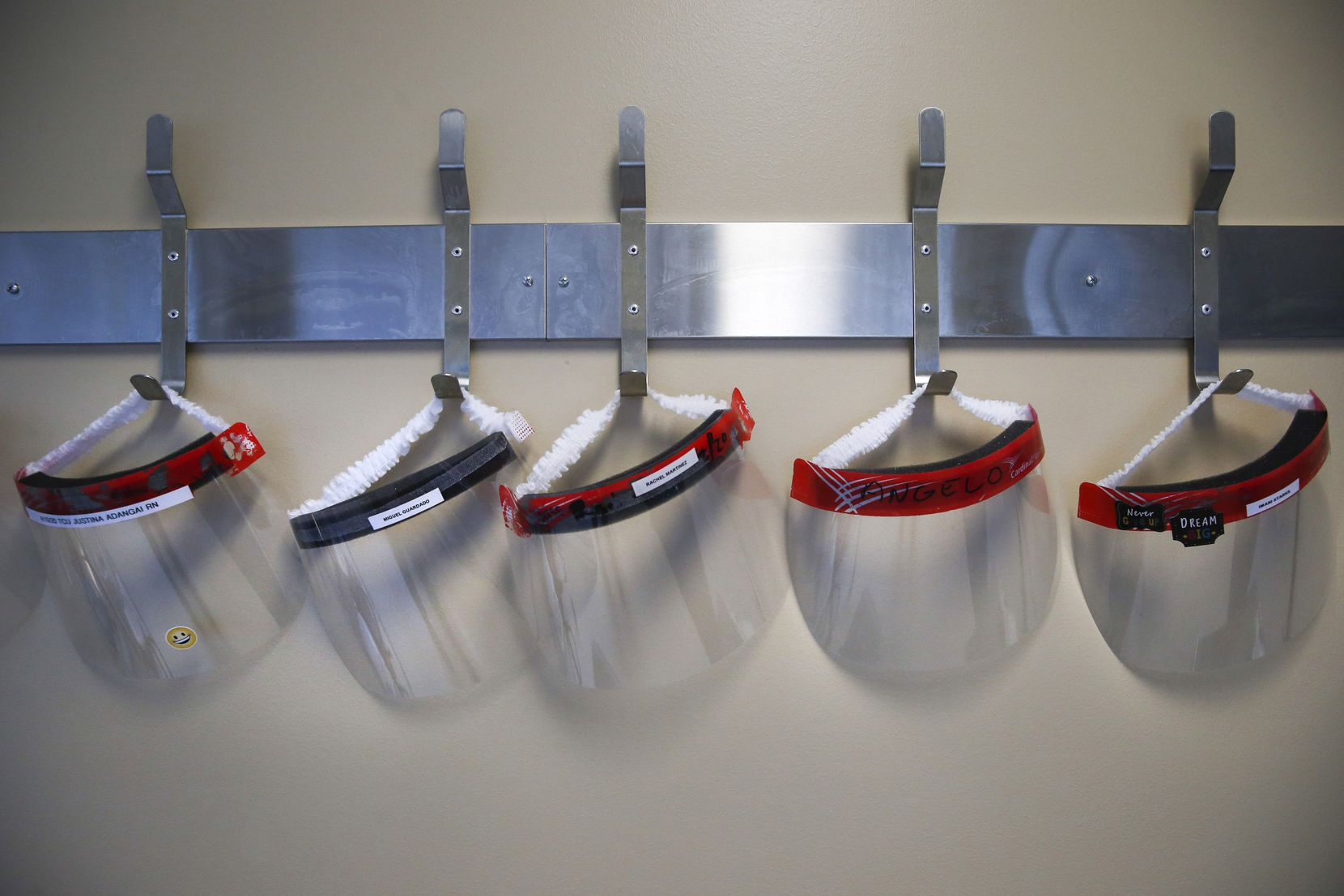 Face shields hang from the wall in the COVID-19 Tactical Care Unit at Parkland Memorial Hospital.
