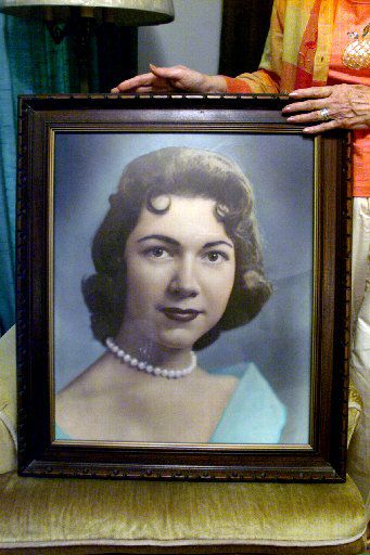 Herlinda de la Vina displayed a picture of her niece, Irene Garza, in this 2003 photo. Garza, 25, was found murdered in McAllen in 1960 after vanishing from Sacred Heart Catholic Church.