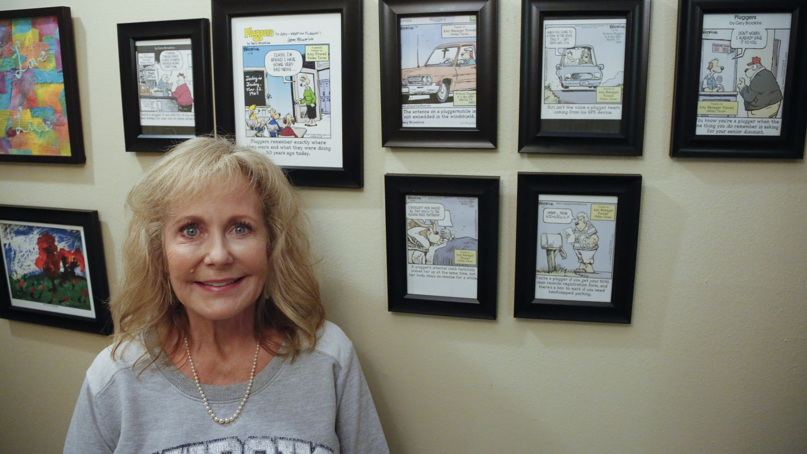 """Amy Powell has supplied the material for several Pluggers cartoons. She keeps a collection of her panels on a """"wall of fame"""" in her Dallas home."""