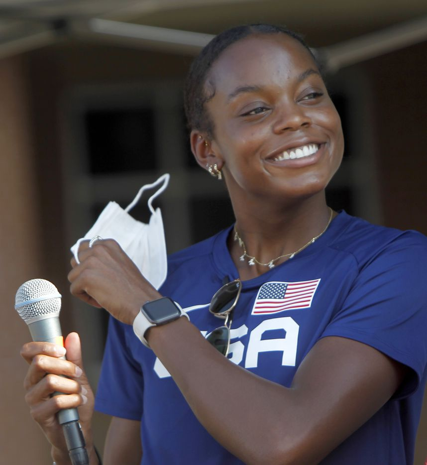 Jasmine Moore removes a facemark to expose a Texas-sized smile as she steps to the microphone to address a large crowd gathered to show their support of the Mansfield track start preparing to depart to compete in the Tokyo Olympics. The Olympic Send-Off for the Mansfield Lake Ridge graduate was held at Danny Jones Middle School in Mansfield on July 21, 2021. (Steve Hamm/ Special Contributor)
