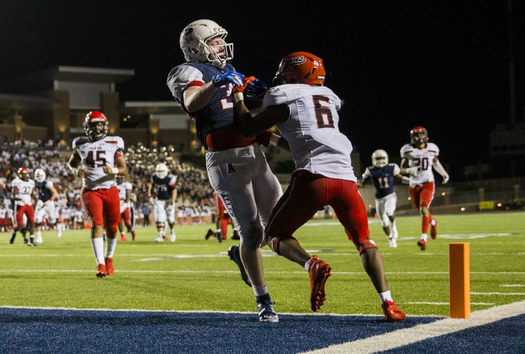 Allen running back Justin Hall (32) makes it across the goal line for a touchdown with Cedar Hill defender Brett Lynch (6) during the fourth quarter of a high school football game between Allen and Cedar Hill on Friday, August 30, 2019 at Eagle Stadium in Allen. (Ashley Landis/The Dallas Morning News)