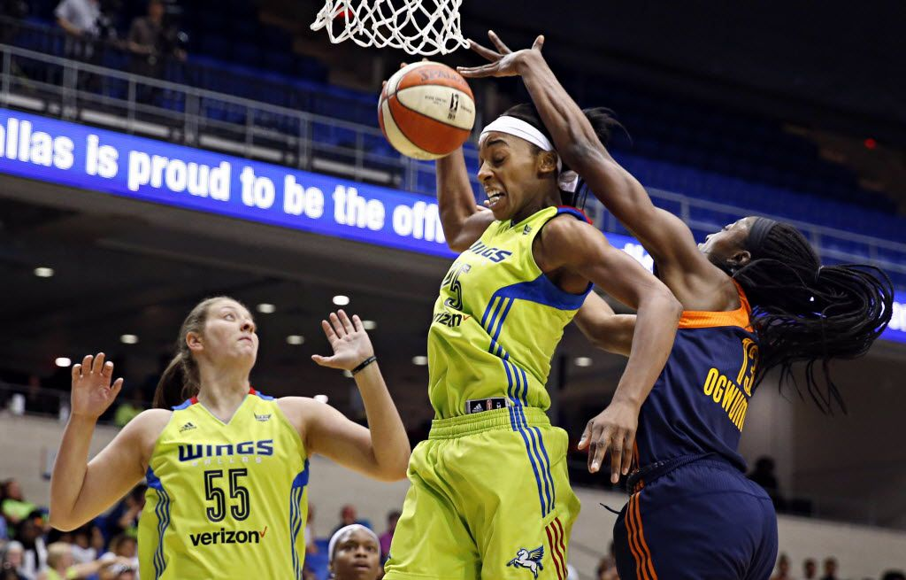 Dallas Wings forward Theresa Plaisance (55) backs off as forward Glory Johnson (25) beats out Connecticut Sun forward Chiney Ogwumike for a rebound during the first half of their game Saturday, July 2, 2016 at College Park Center in Arlington, Texas. (G.J. McCarthy/The Dallas Morning News)
