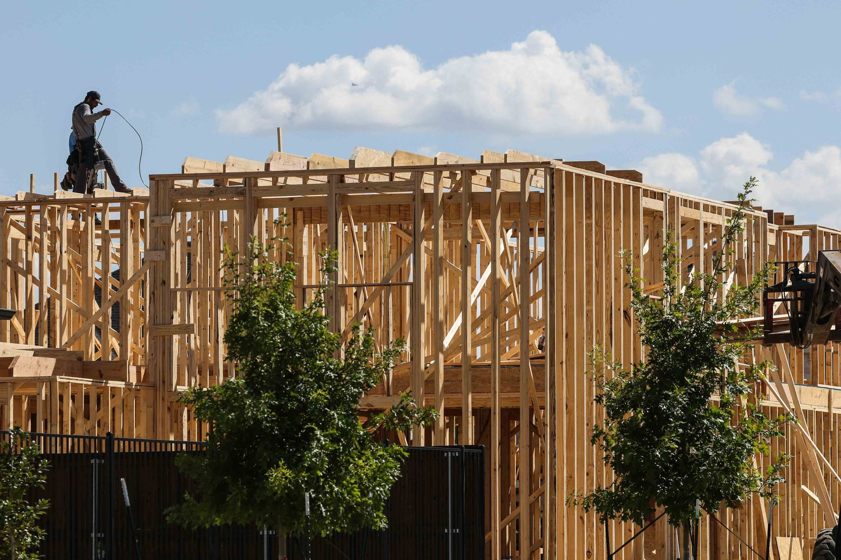 A home under construction in August at The Grove development on Copperbeach Street in Frisco.