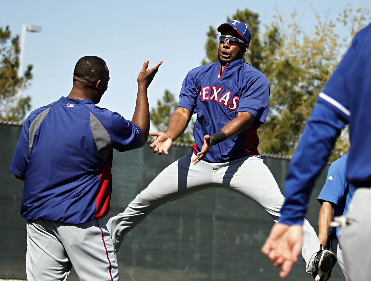 Texas Rangers infielders Elvis Andrus (right) and Adrian Beltre joke around during spring training camp Saturday, March 3, 2012 at the Surprise Sports Complex in Surprise, Ariz. (G.J. McCarthy/The Dallas Morning News)