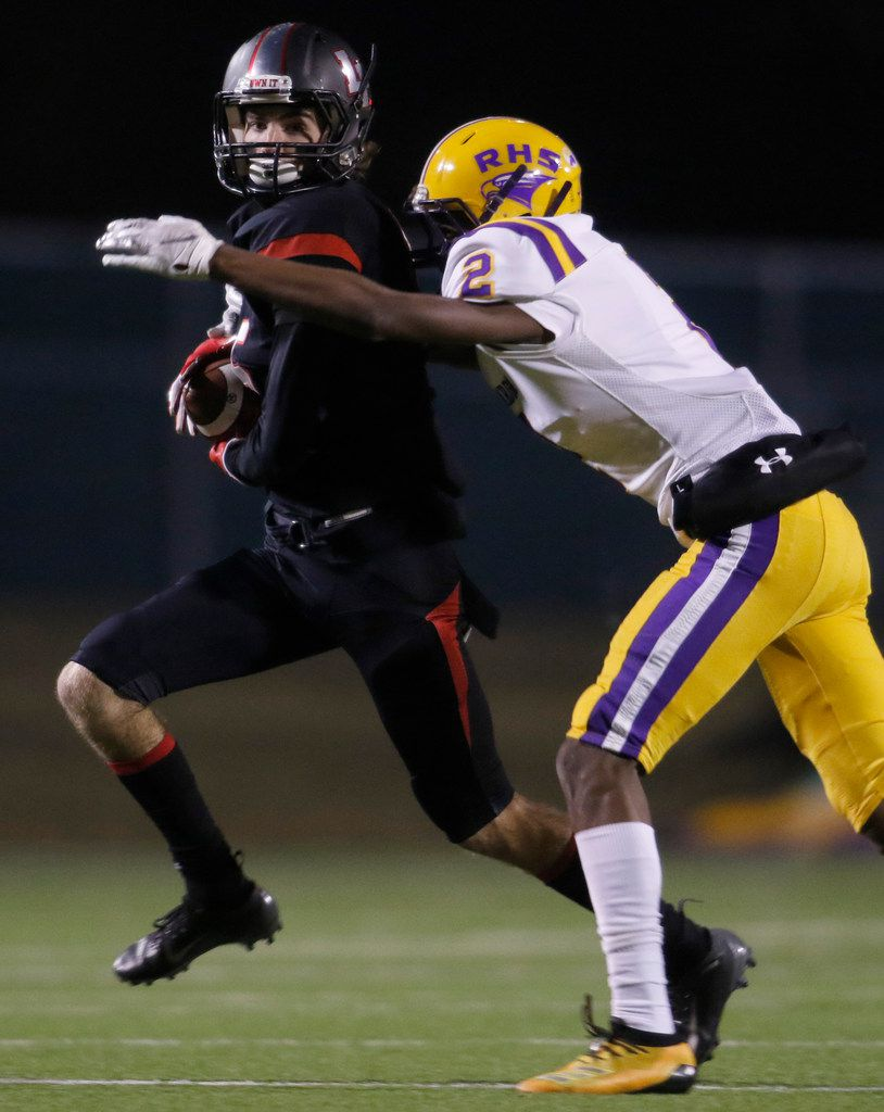 Lake Highlands receiver Evan Moudy (5) tacks yardage onto a reception for a long gainer as Richardson defender Anthony Vaughan (2) moves in to make the tackle during second quarter action. The two teams played their District 8-6A football game at Wildcat-Ram Stadium on the campus of Lake Highlands High School in Dallas on November 8, 2019. (Steve Hamm/ Special Contributor)
